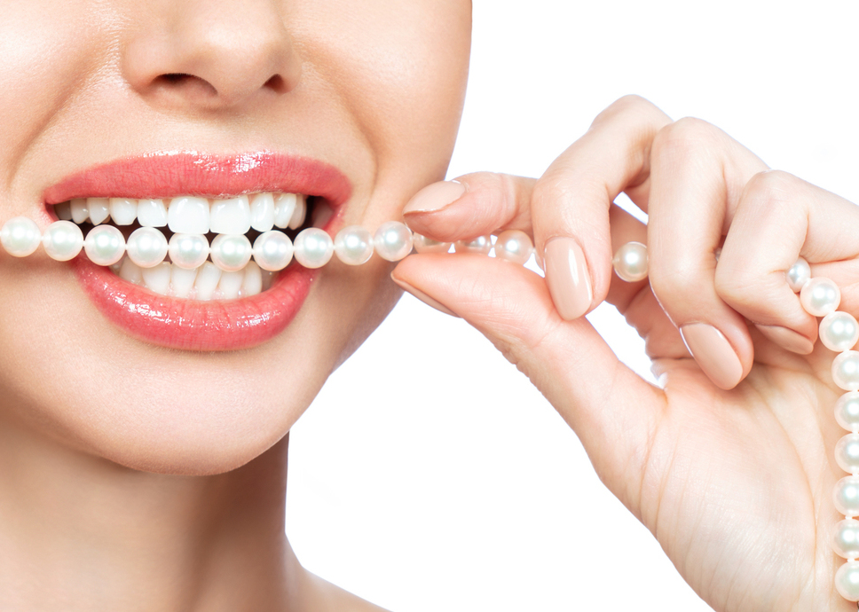 Beautiful female smile and pearl necklace, Dental Health Concept
